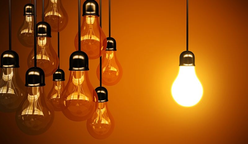 idea concept with light bulbs on a orange background
