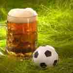 Mug of fresh lager beer and small soccer ball on the grass. Illustration for the sports bar